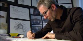 Karel Willemen aan de tekentafel